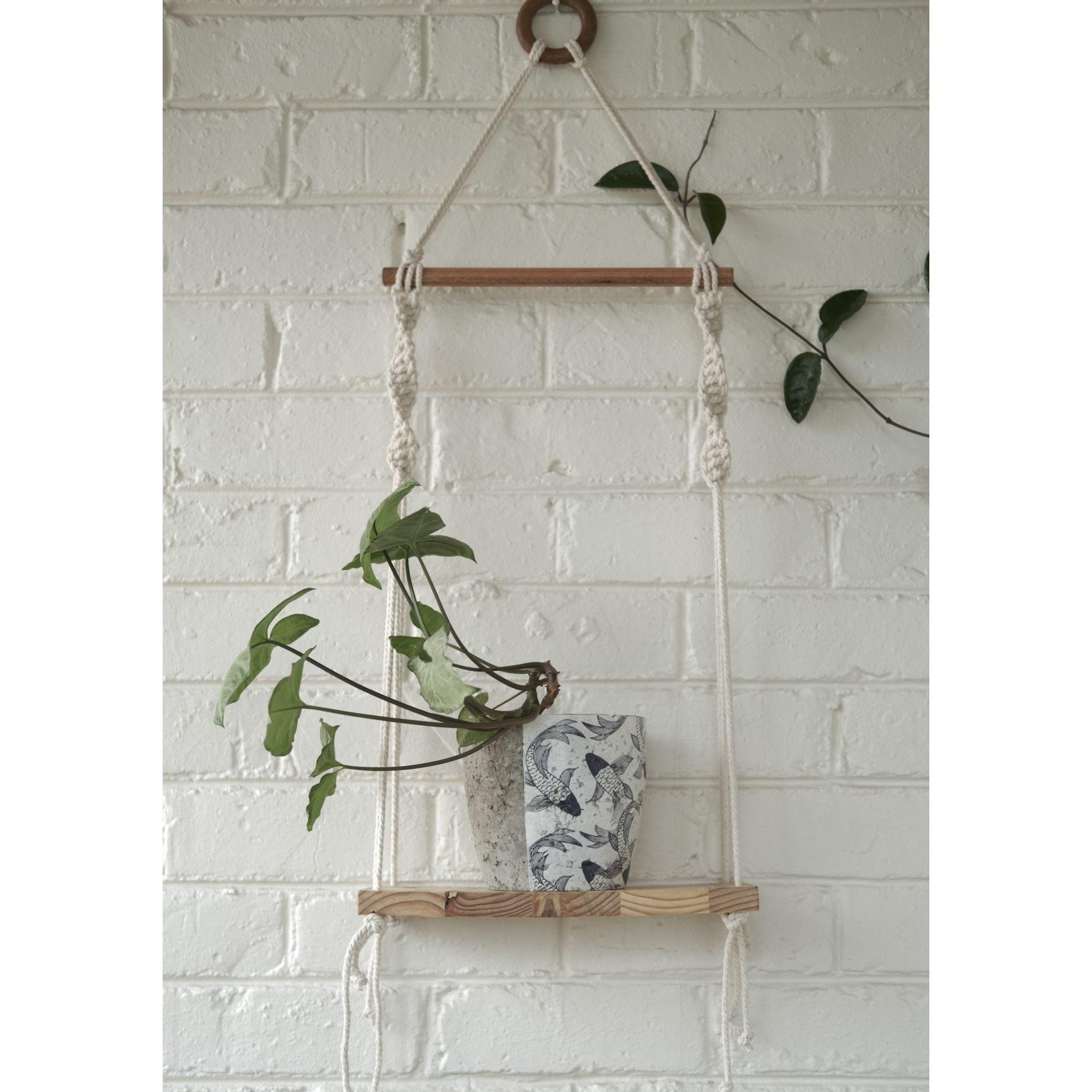 Classic macramé shelf with koi fish plant pot