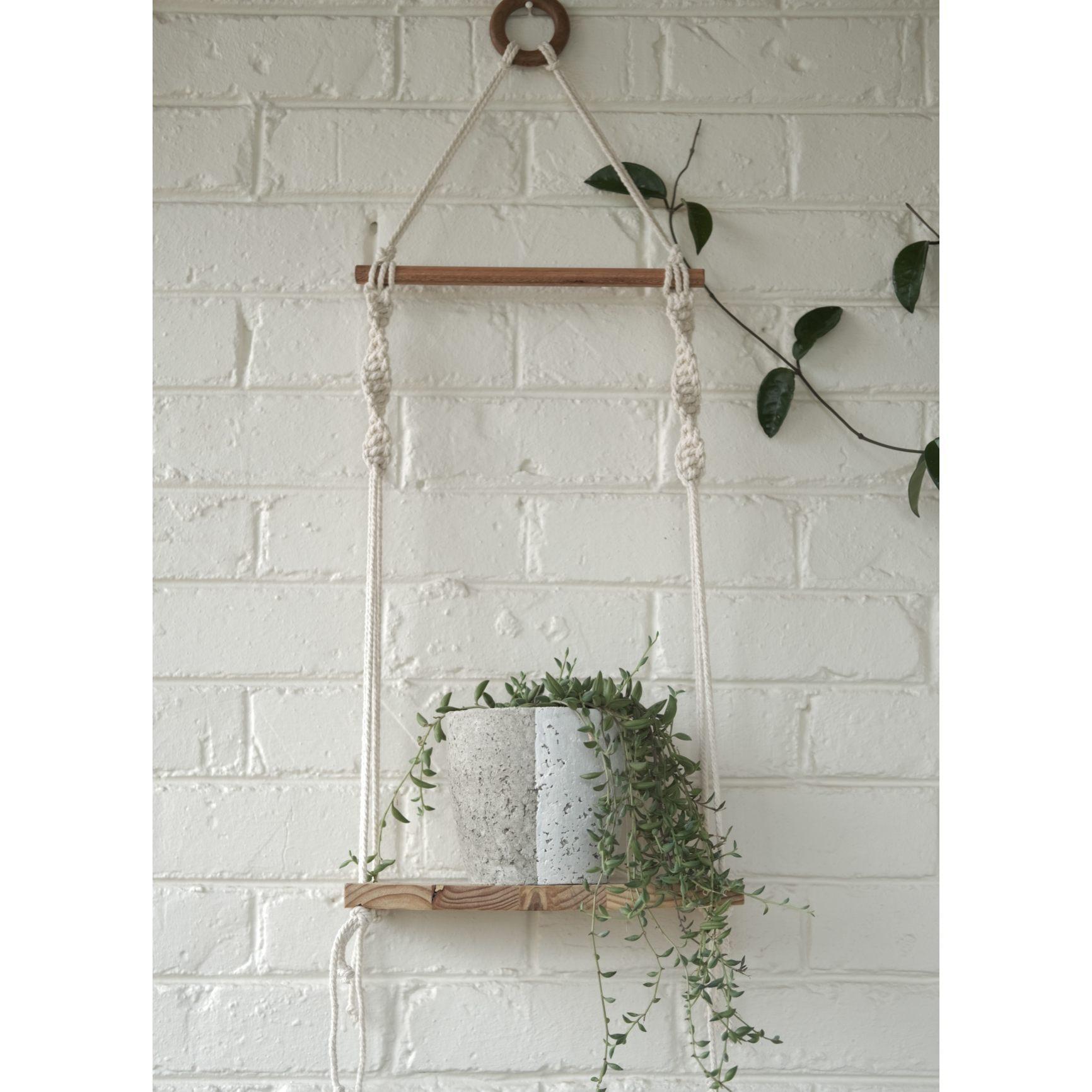 Classic macramé shelf with white plant pot