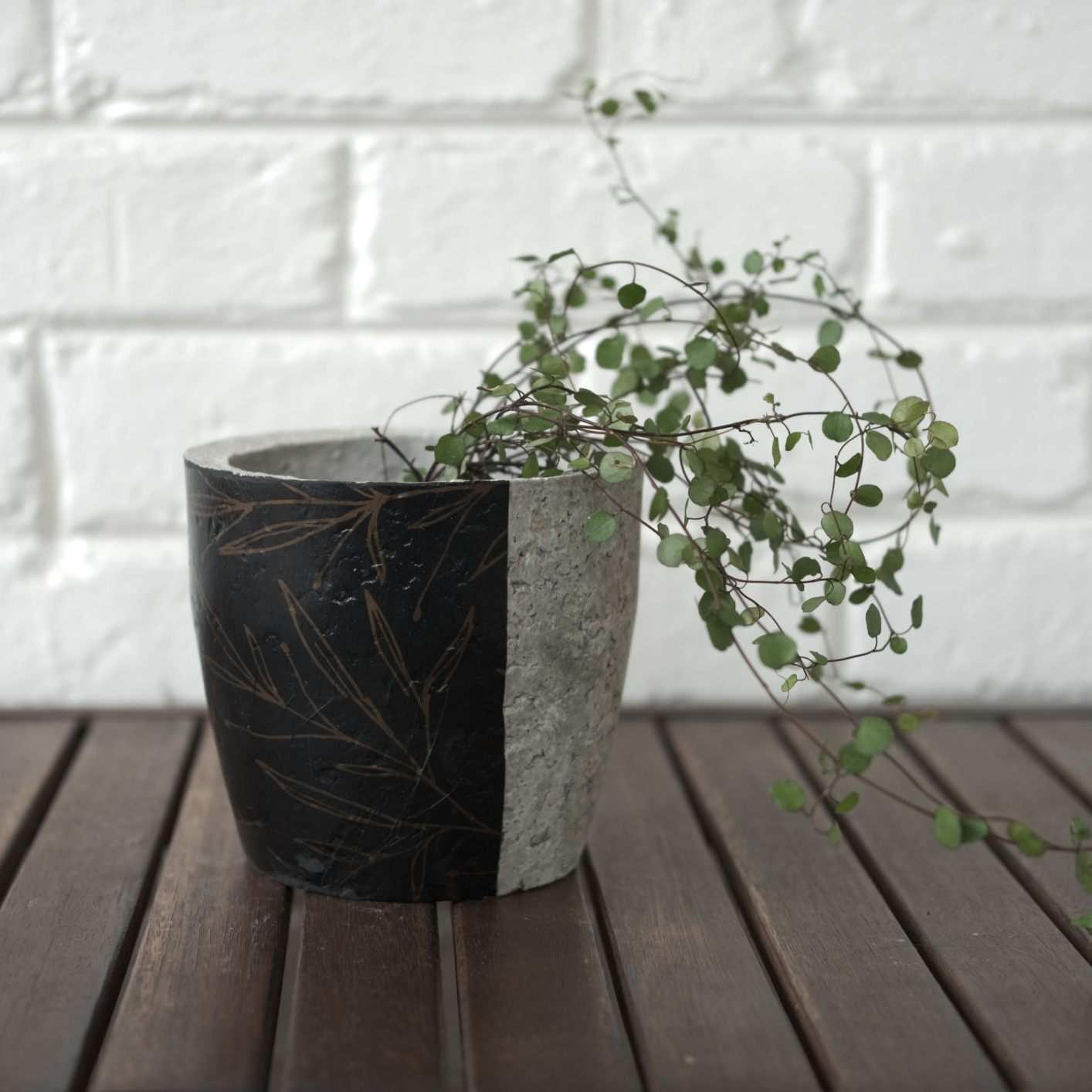 Plant pot with black and gold floral print