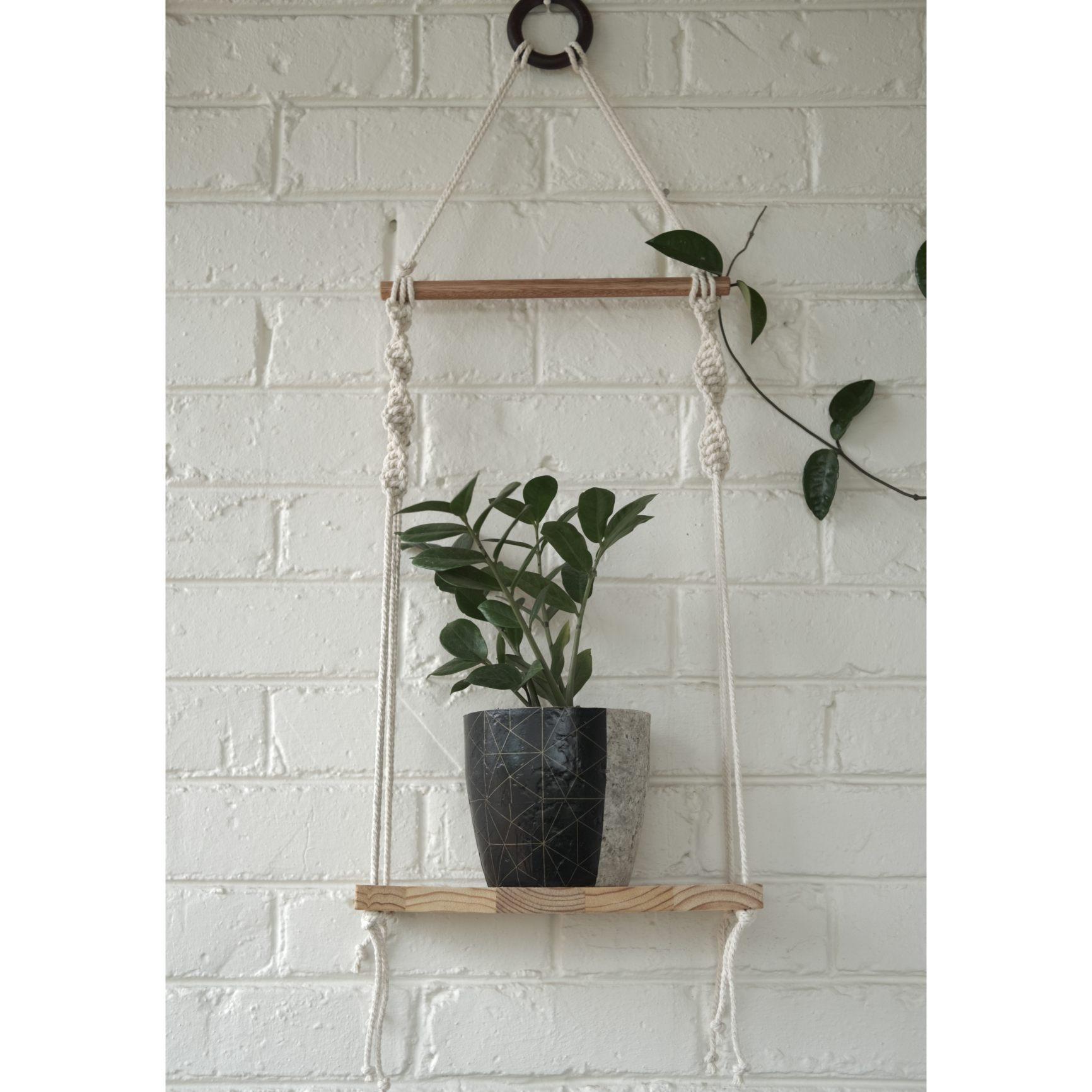 Classic macramé shelf with black geometric plant pot