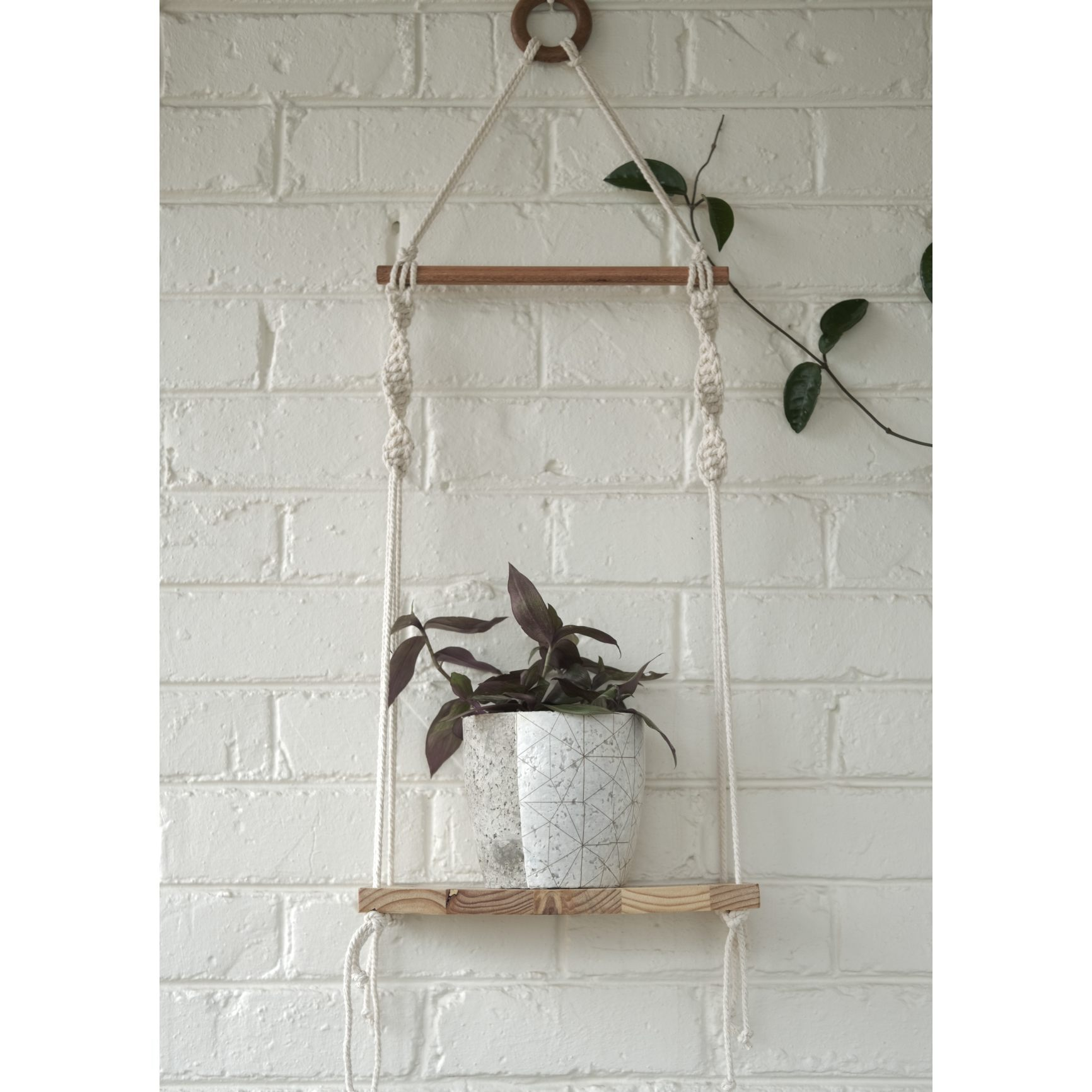 Classic macramé shelf with white geometric plant pot