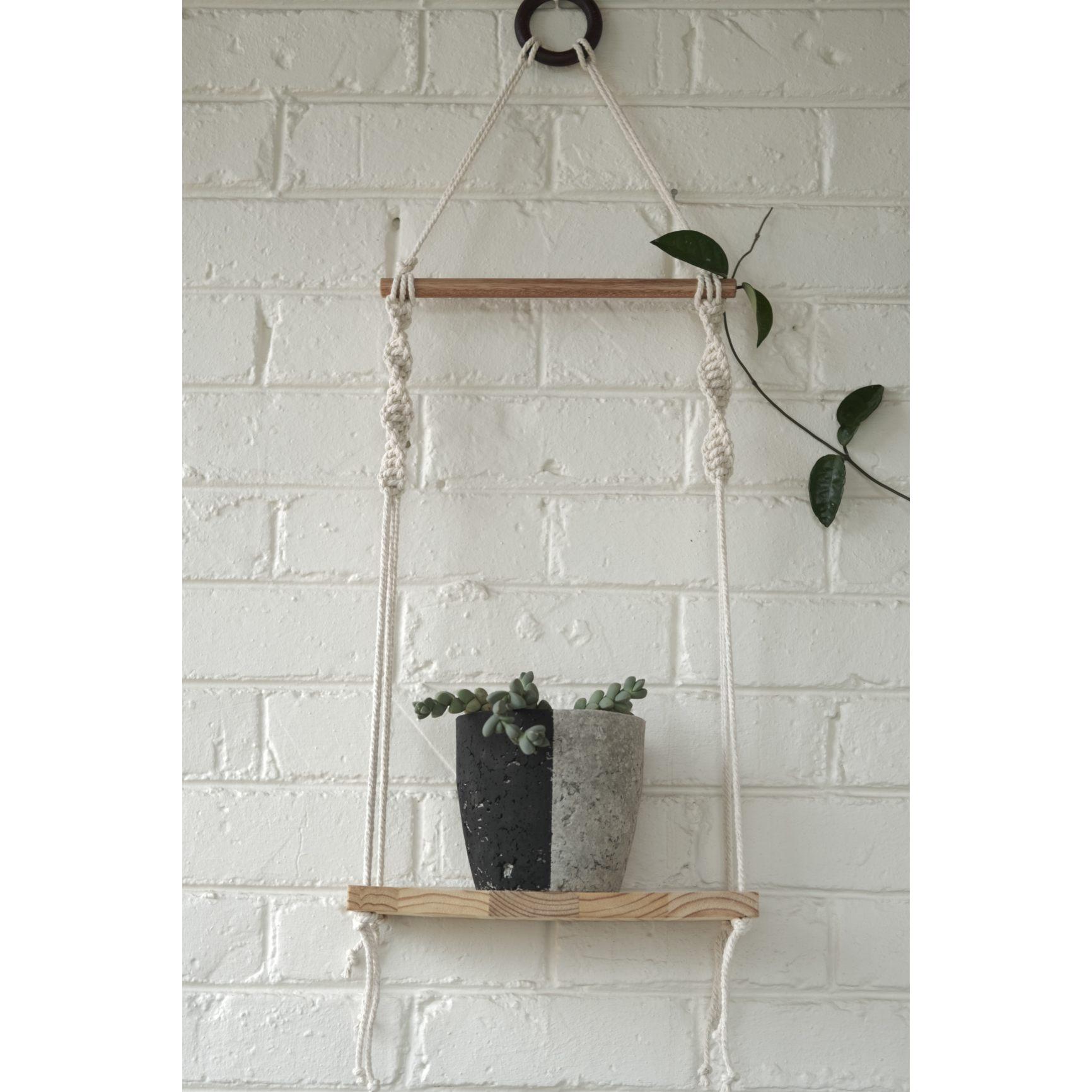 Classic macramé shelf with black plant pot