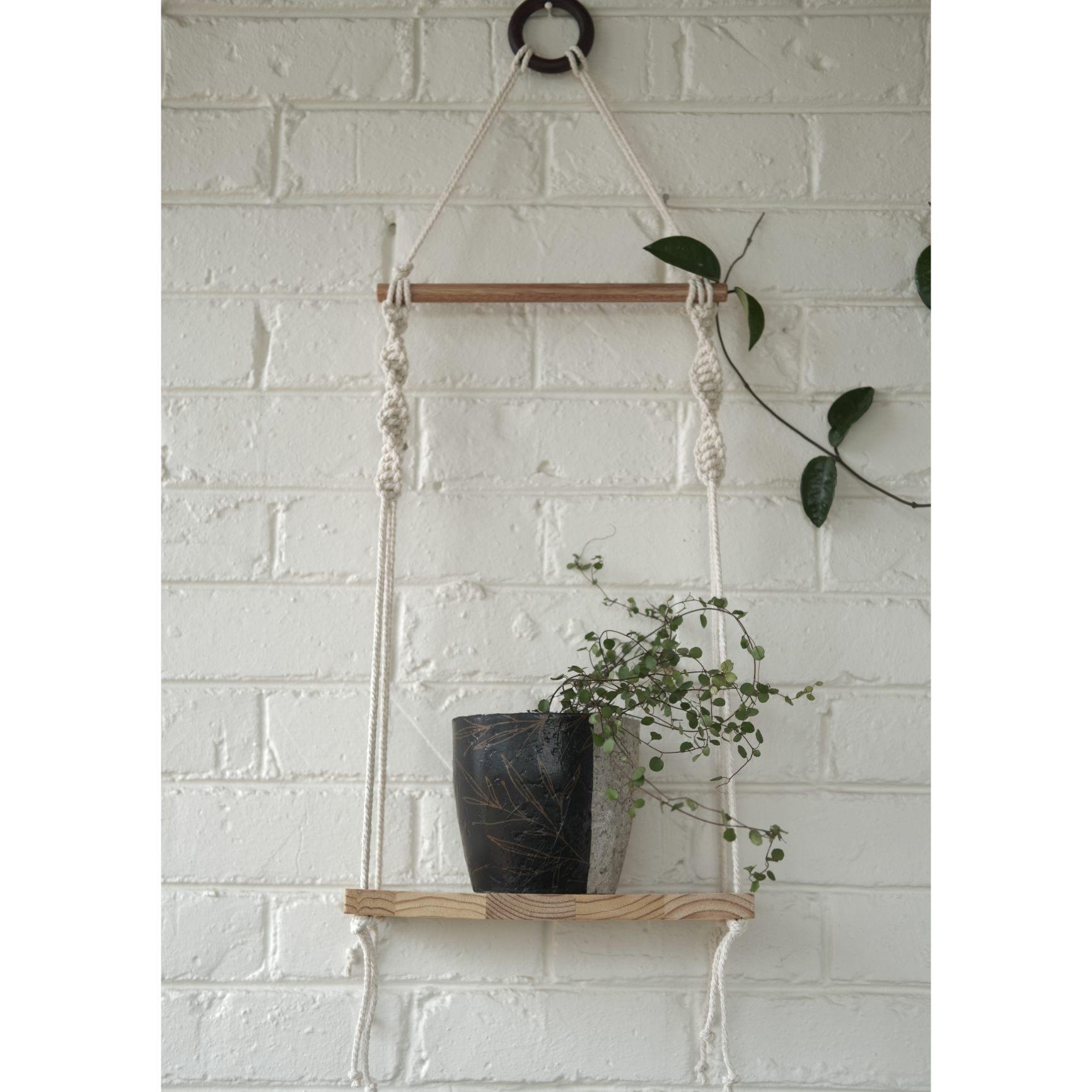 Classic macramé shelf with floral plant pot