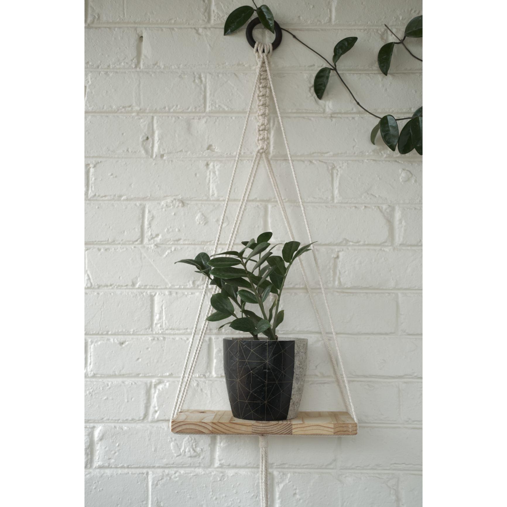 Modern macramé shelf with black geometric plant pot