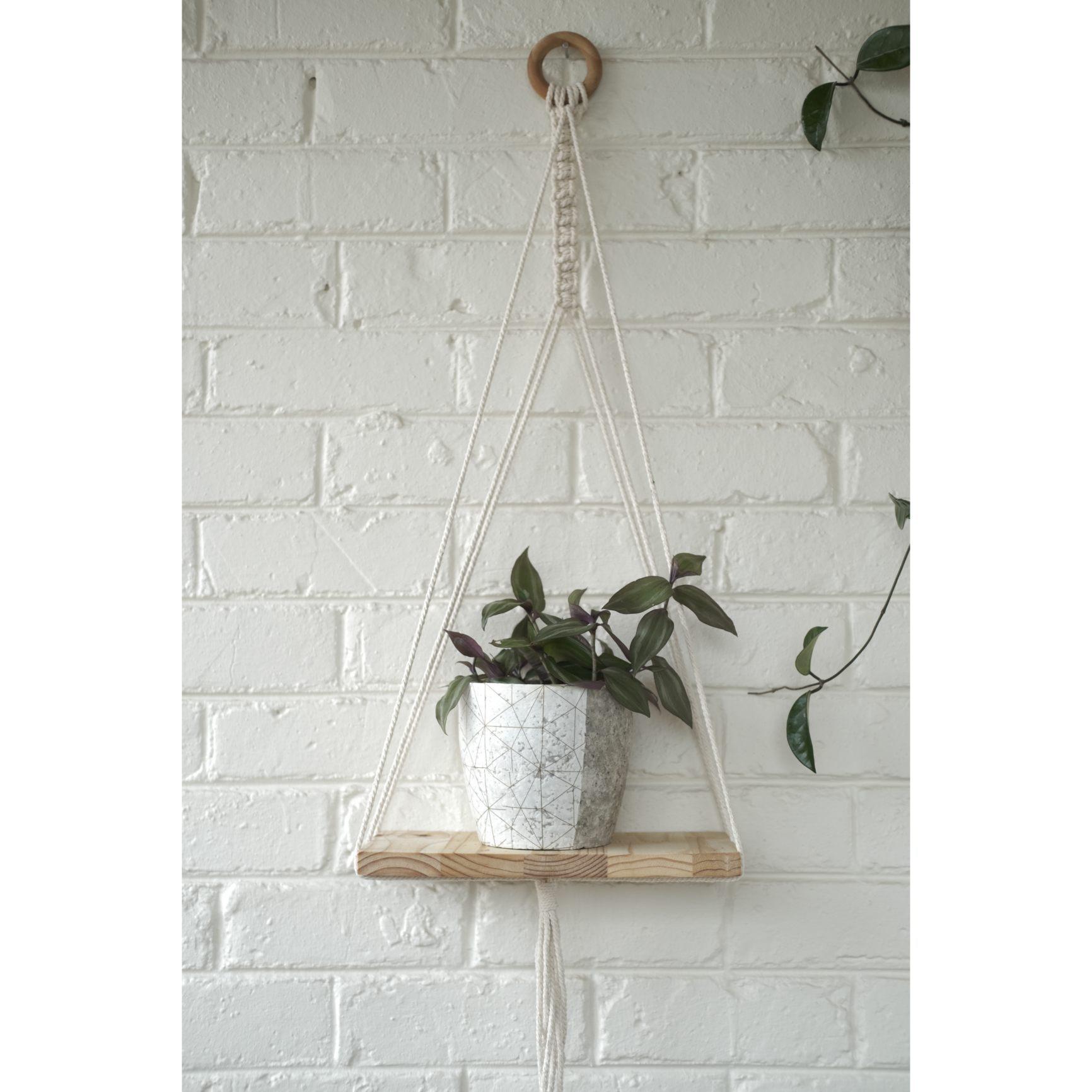 Modern macramé shelf with white geometric plant pot